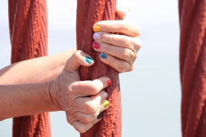 Image of fingers gripping a post